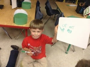 Adriaan enjoys  writing words he knows during Free Write.