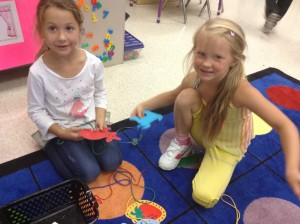 Hannah and Diora enjoy threading patterns during Exploration time, and they are working on fine motor skills at the same time!