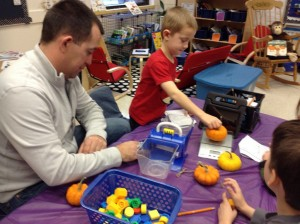 Estimating and weighing our pumpkins' weight.