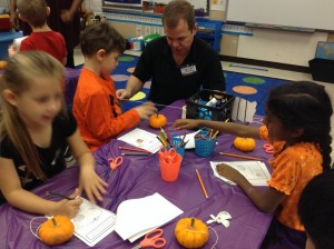 Measuring the circumference of our pumpkins.