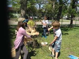 Look what can happen when you give children some sticks, burlap and let them work together and use their imagination!