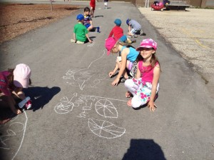 Having fun problem-solving with chalk on pavement!